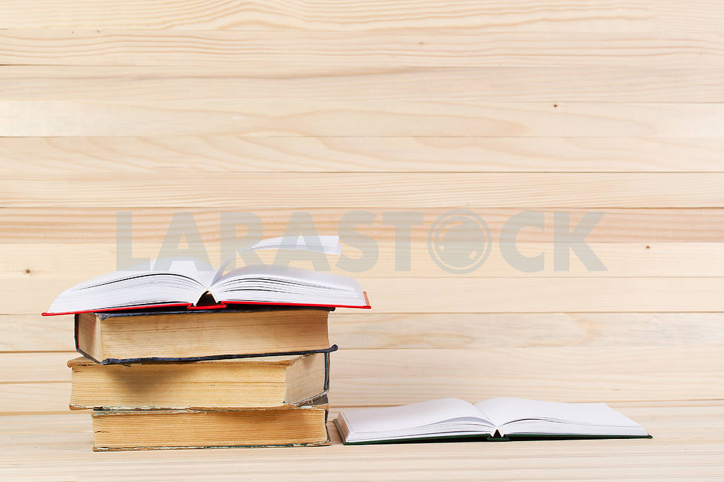 Stack of hardback books on wooden table. Back to school. — Image 47266