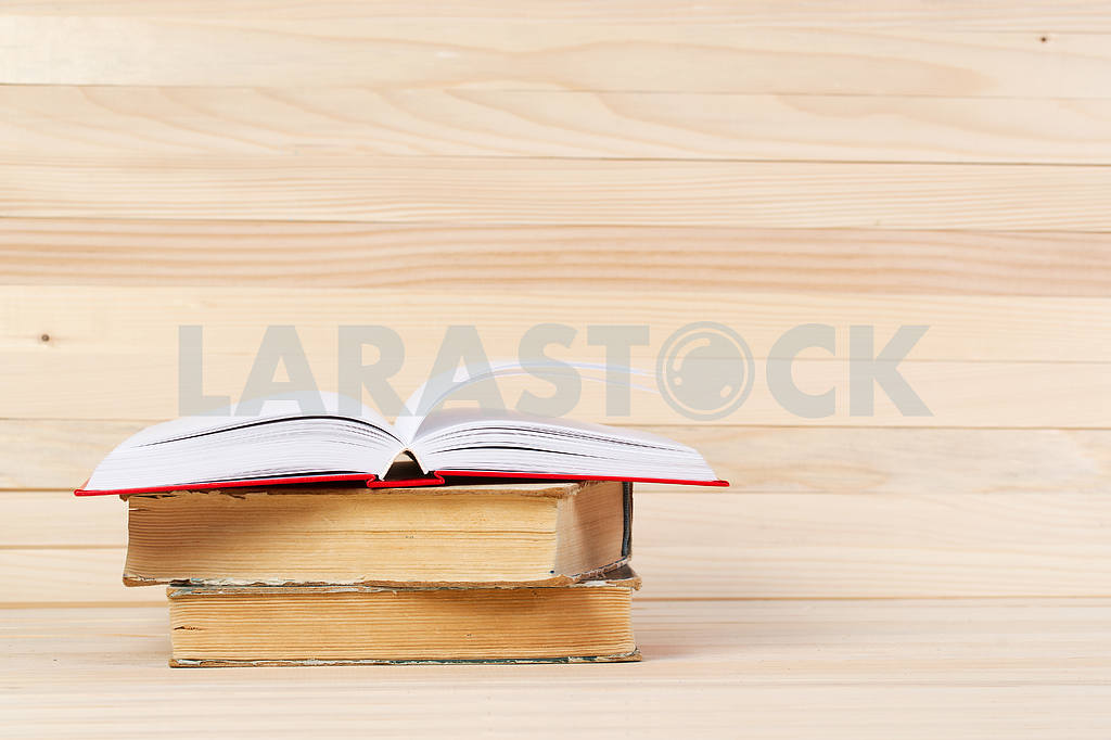 Stack of hardback books on wooden table. Back to school. — Image 47268