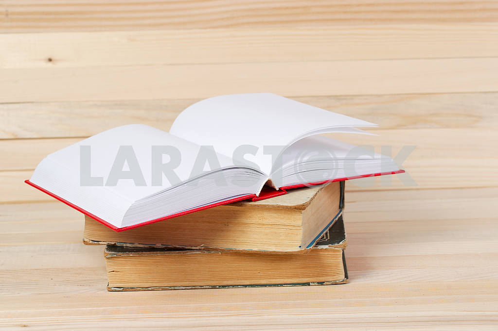 Stack of hardback books on wooden table. Back to school. — Image 47270