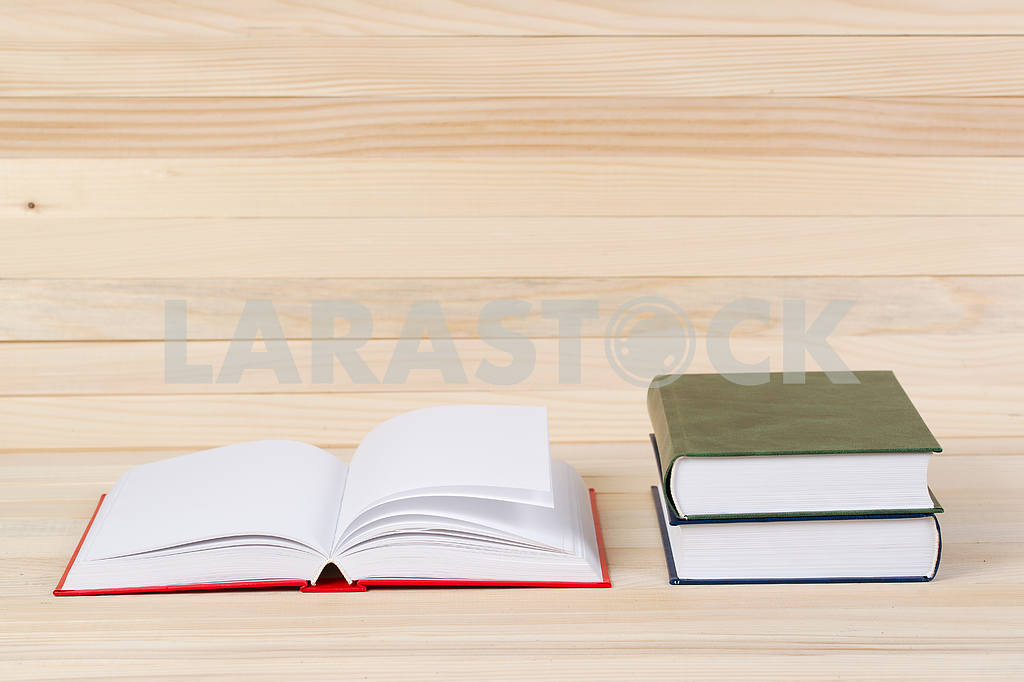 Stack of hardback books on wooden table. Back to school. — Image 47277