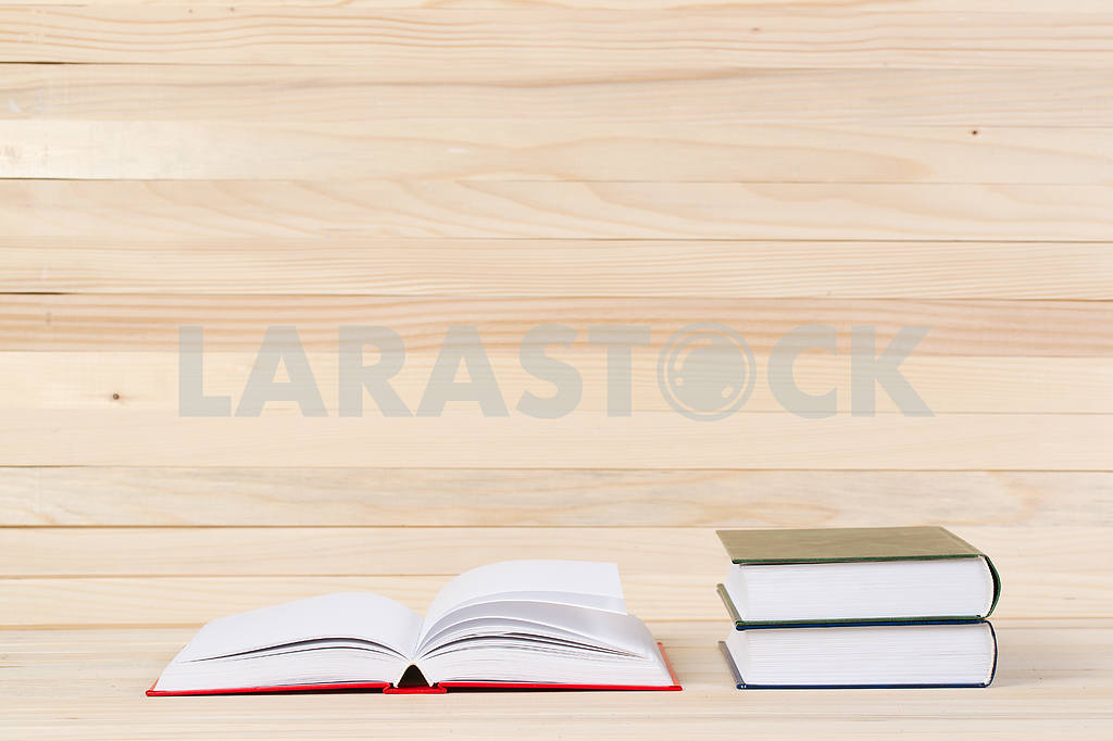 Stack of hardback books on wooden table. Back to school. — Image 47278