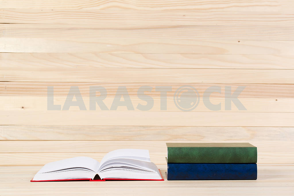 Stack of hardback books on wooden table. Back to school. — Image 47279