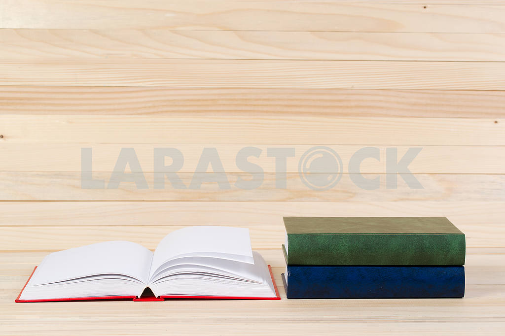Stack of hardback books on wooden table. Back to school. — Image 47280