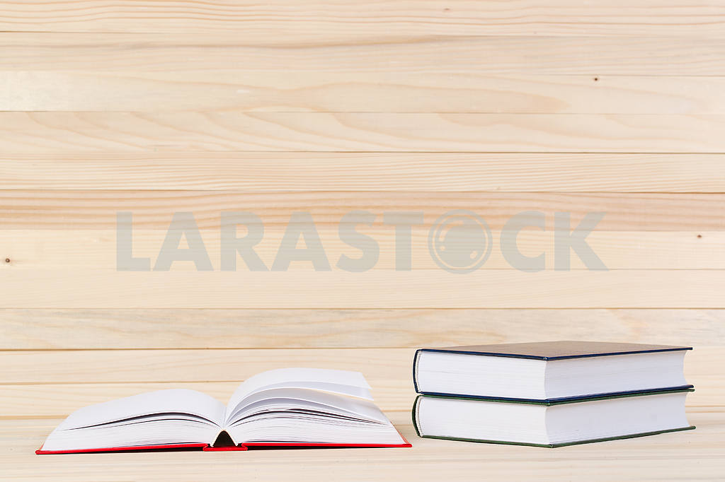 Stack of hardback books on wooden table. Back to school. — Image 47282