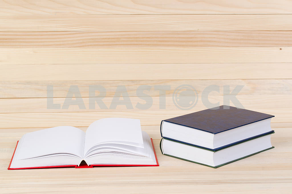 Stack of hardback books on wooden table. Back to school. — Image 47283