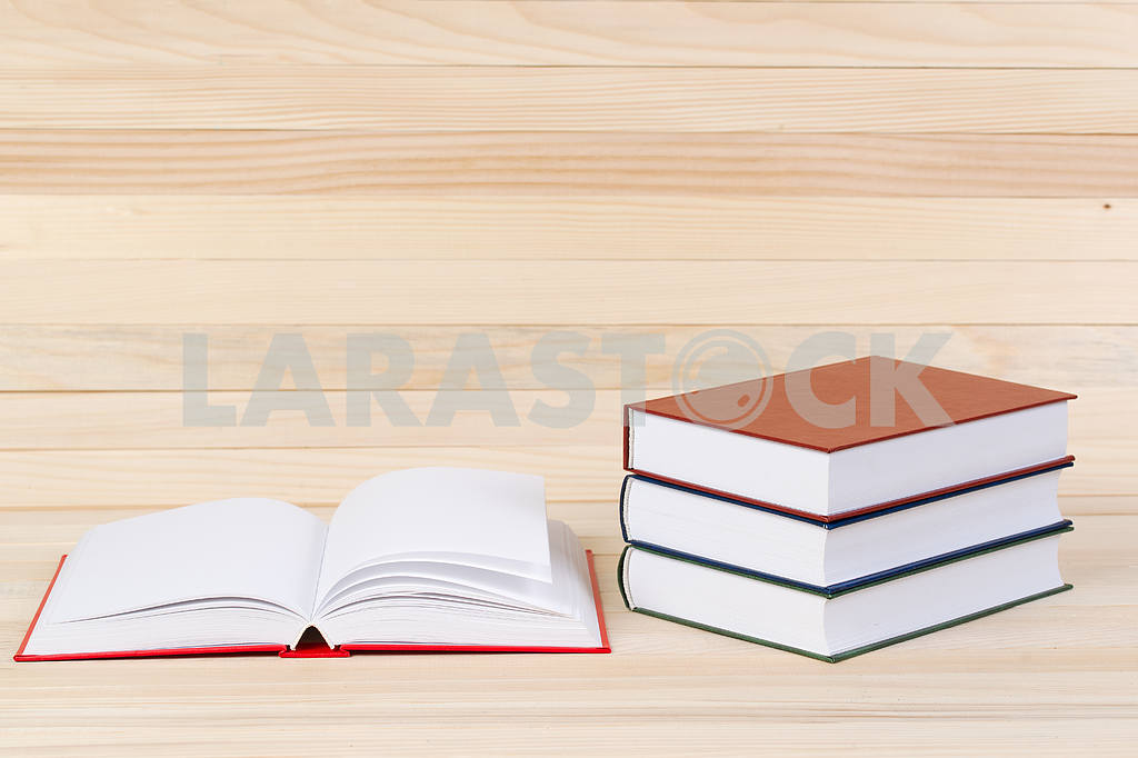 Stack of hardback books on wooden table. Back to school. — Image 47285