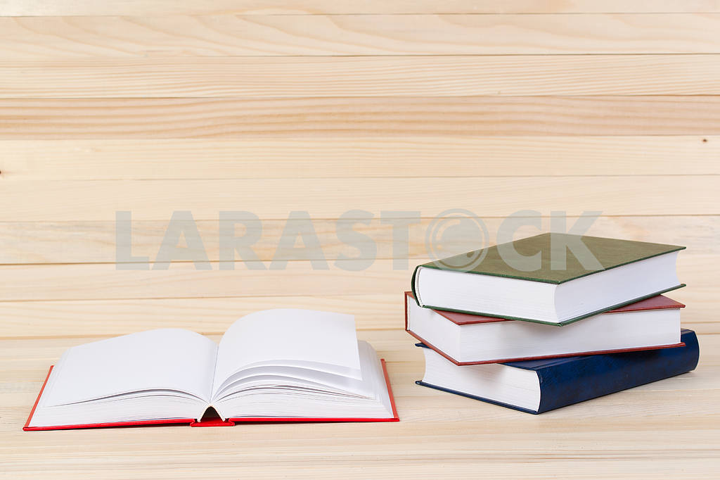 Stack of hardback books on wooden table. Back to school. — Image 47289