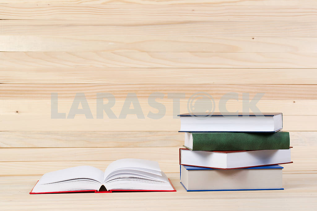 Stack of hardback books on wooden table. Back to school. — Image 47291