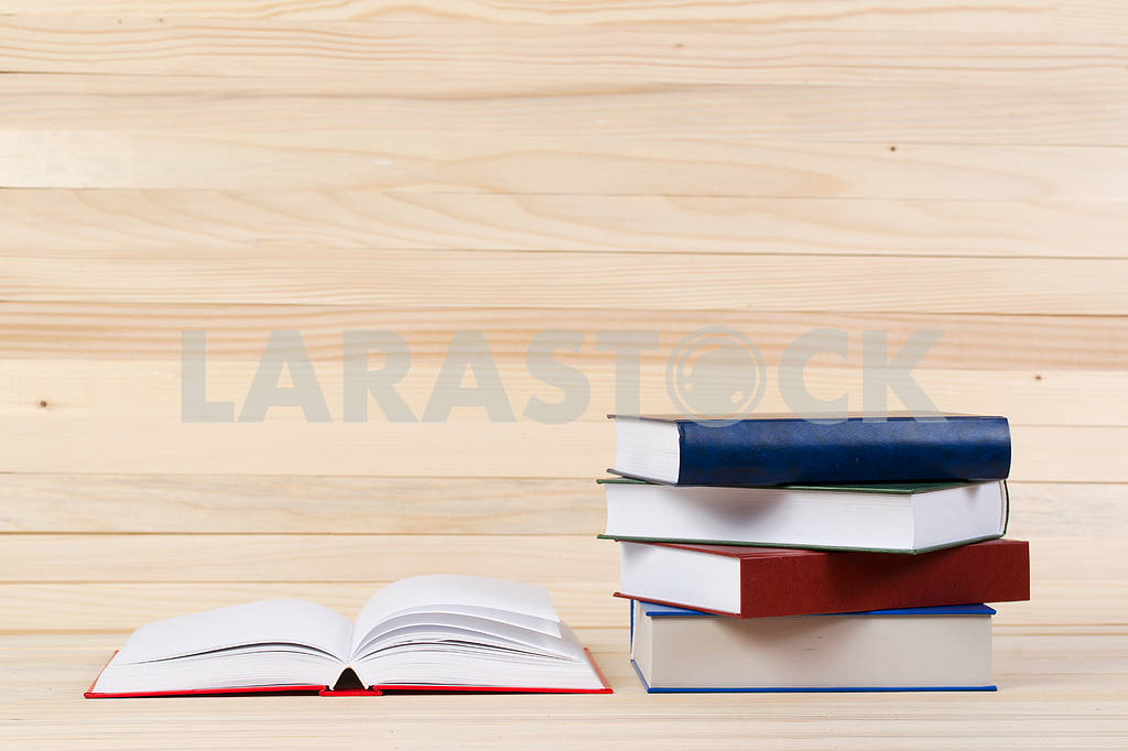 Stack of hardback books on wooden table. Back to school. — Image 47292
