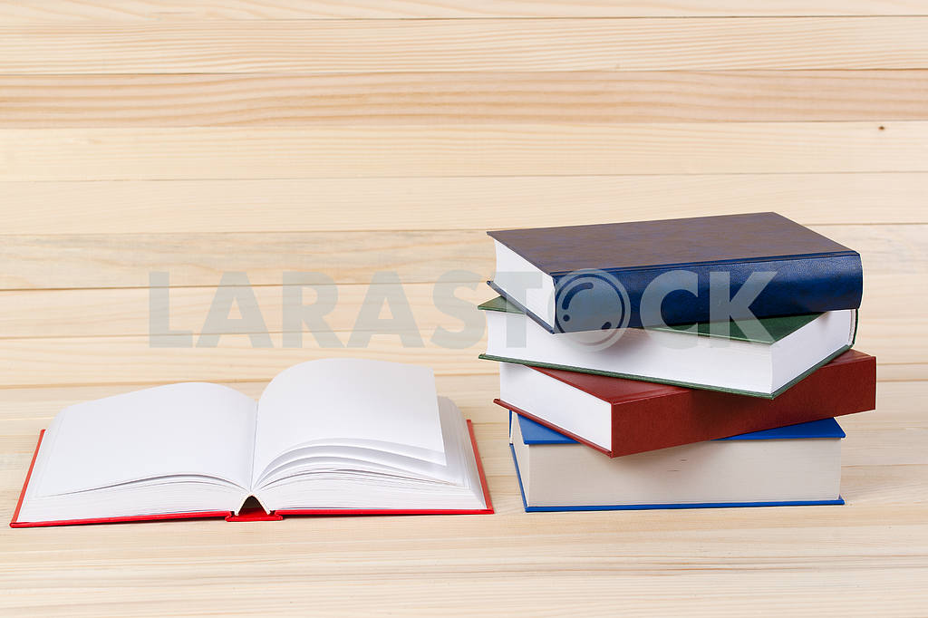 Stack of hardback books on wooden table. Back to school. — Image 47293