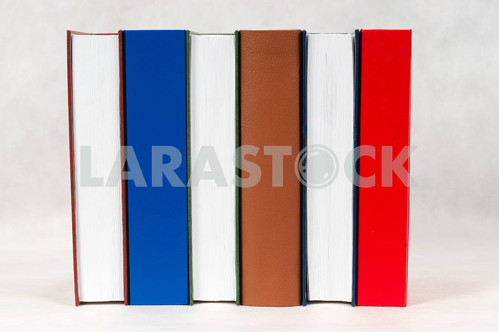 Stack of hardback books on wooden table. Back to school. — Image 47310