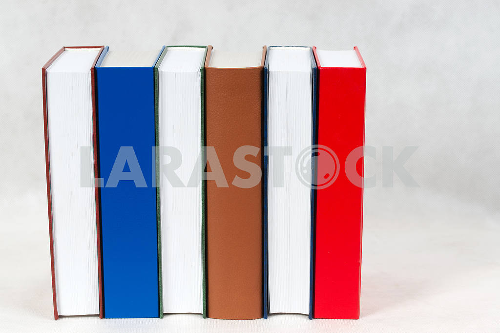 Stack of hardback books on wooden table. Back to school. — Image 47311