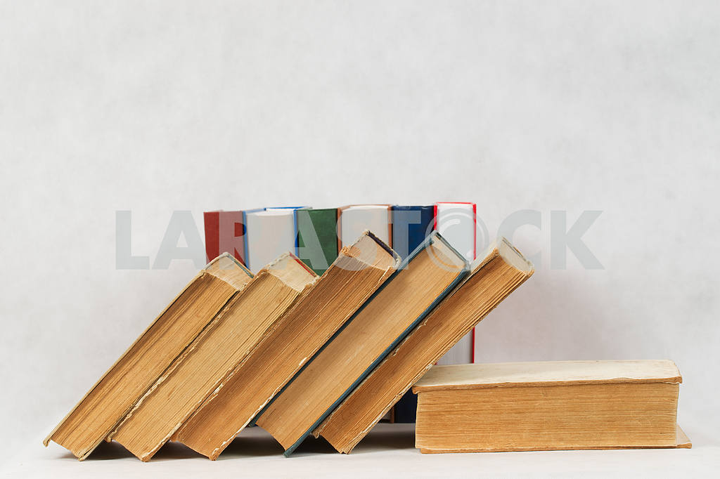 Stack of hardback books on wooden table. Back to school. — Image 47315