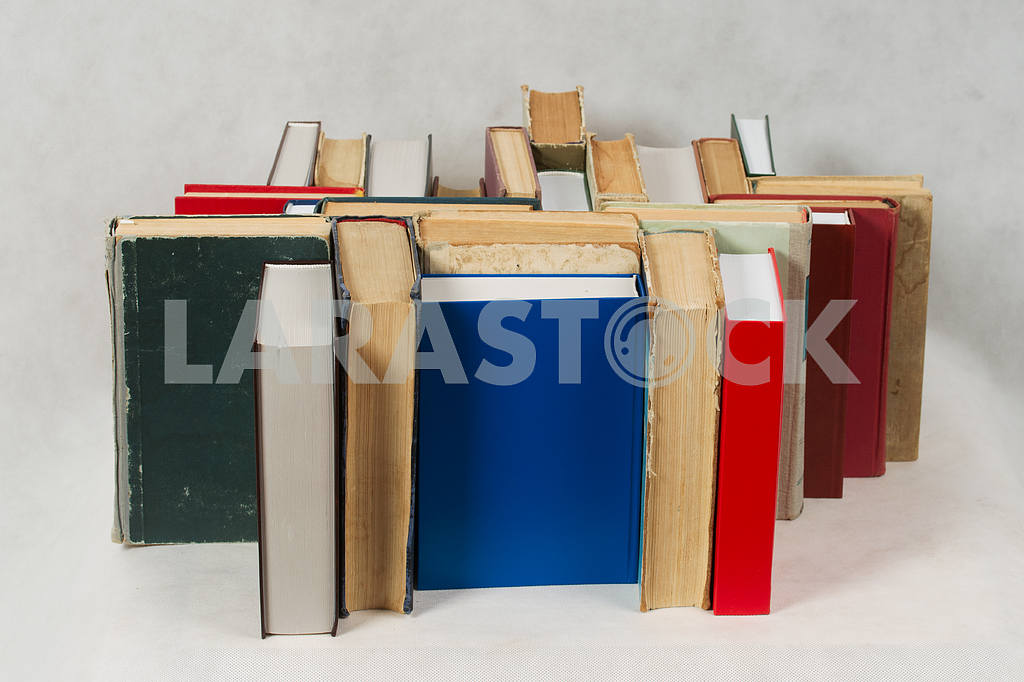 Stack of hardback books on wooden table. Back to school. — Image 47319