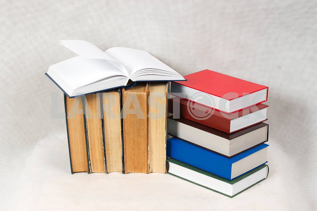 Stack of hardback books on wooden table. Back to school. — Image 47321