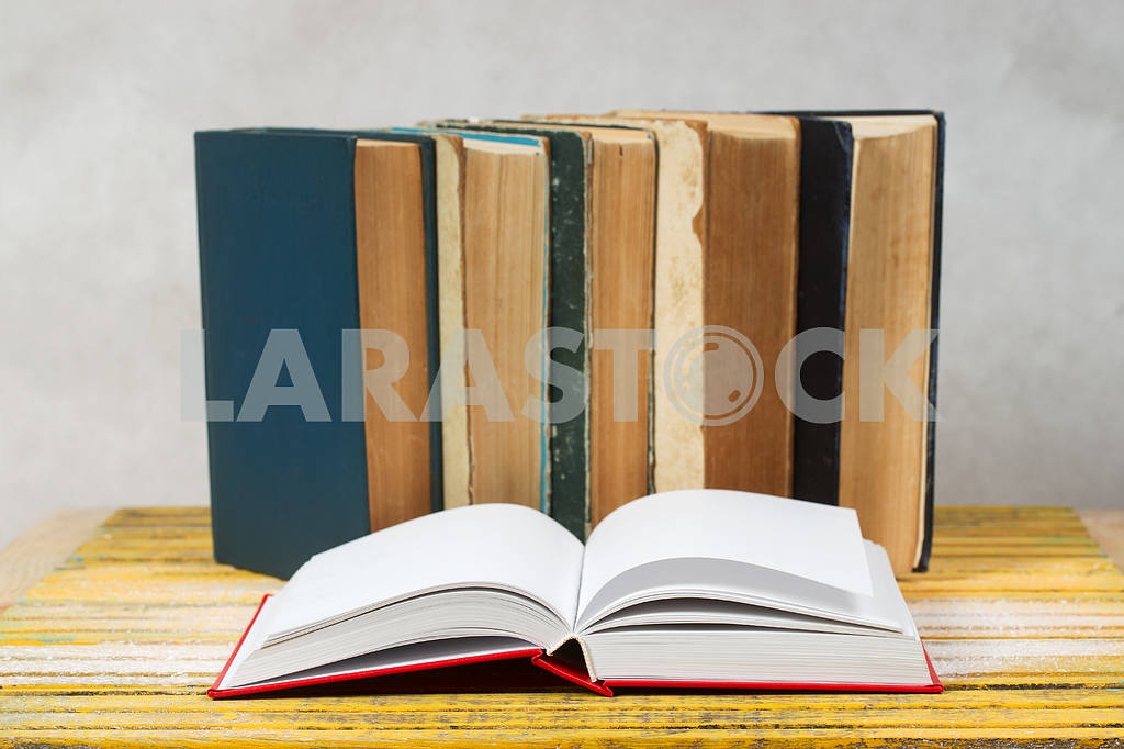 Stack of hardback books on wooden table. Back to school. — Image 47324