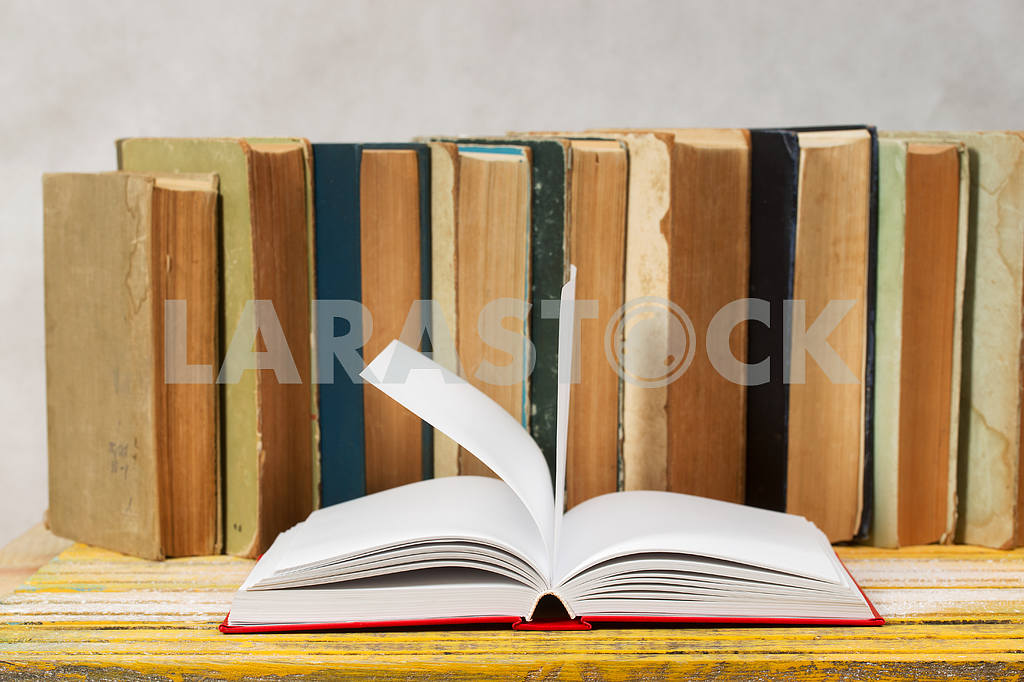 Stack of hardback books on wooden table. Back to school. — Image 47325