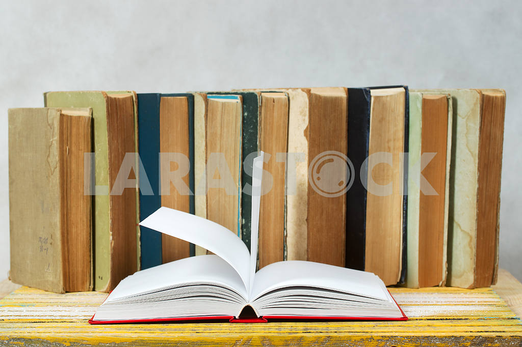 Stack of hardback books on wooden table. Back to school. — Image 47326