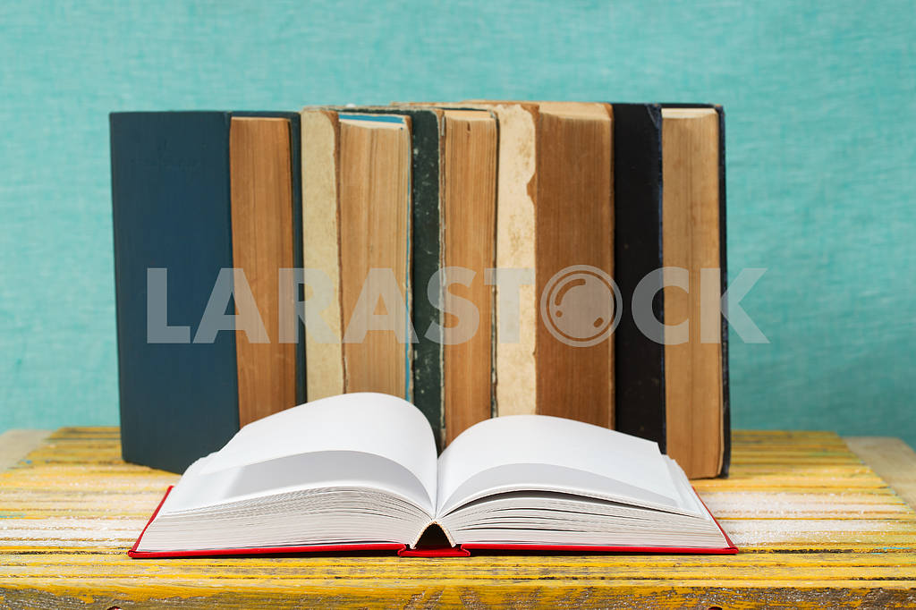Stack of hardback books on wooden table. Back to school. — Image 47327
