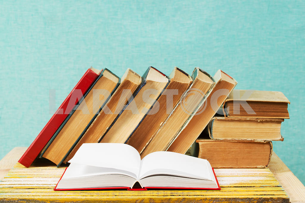 Stack of hardback books on wooden table. Back to school. — Image 47334