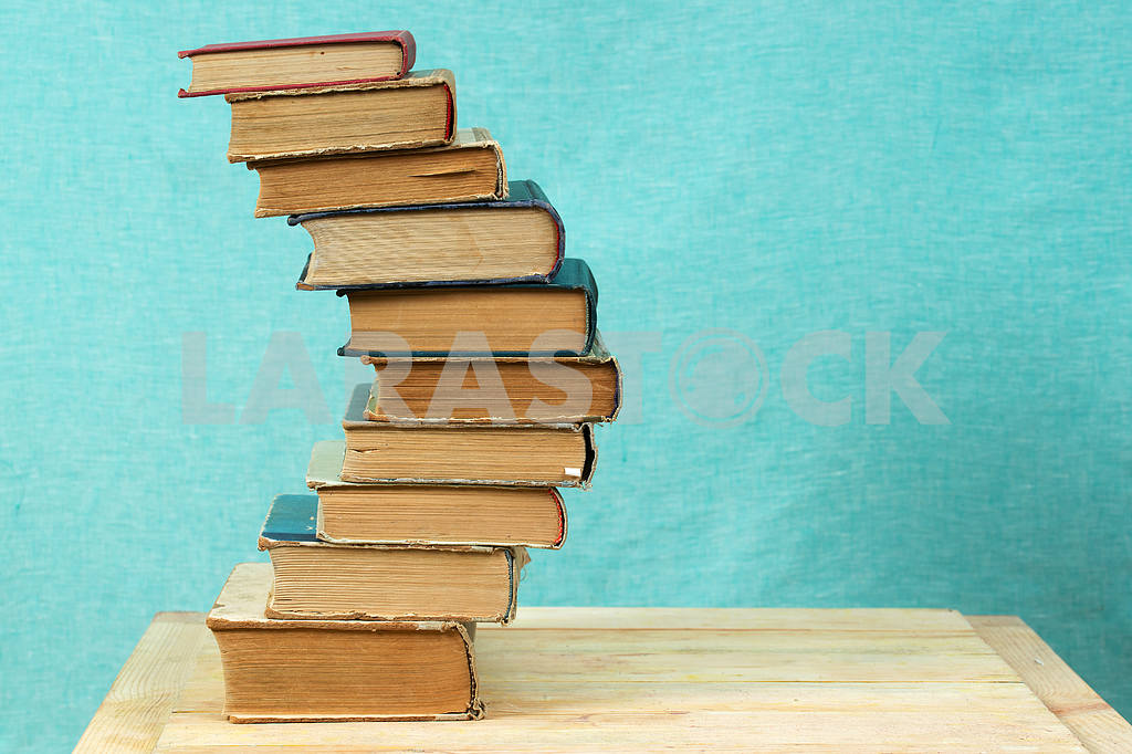 Stack of hardback books on wooden table. Back to school. — Image 47340