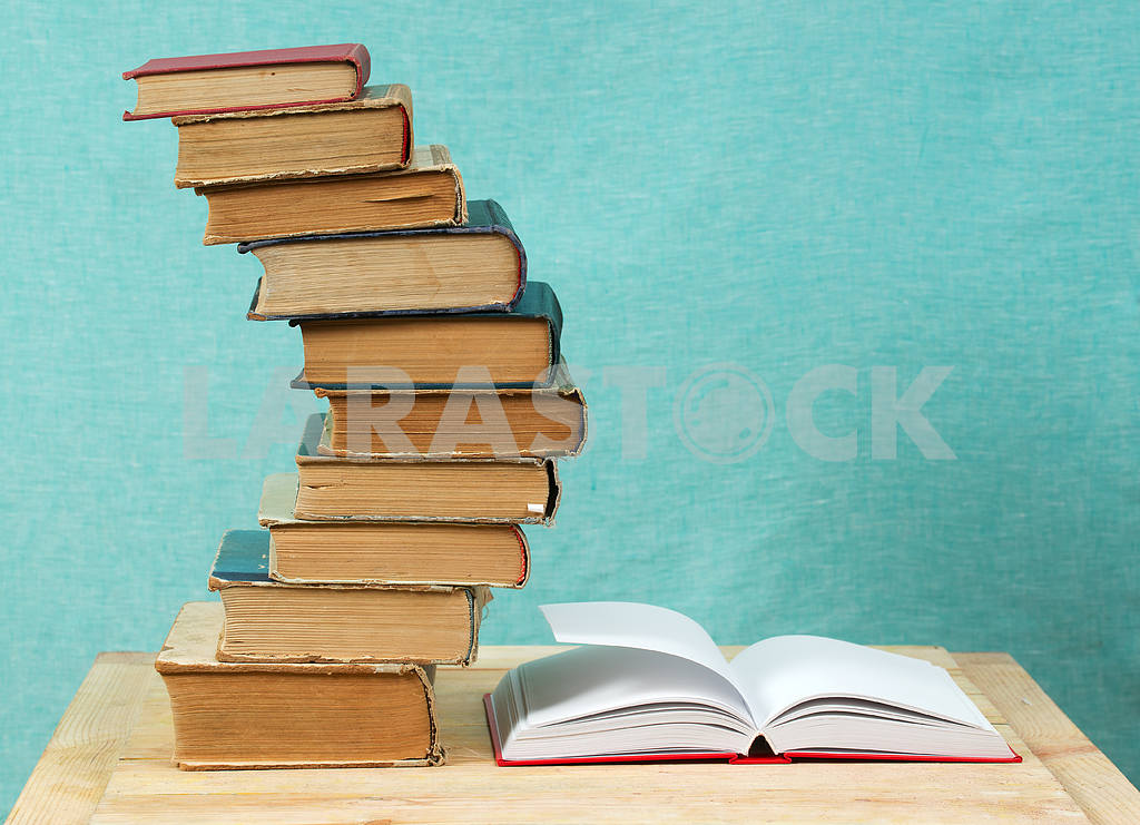 Stack of hardback books on wooden table. Back to school. — Image 47341