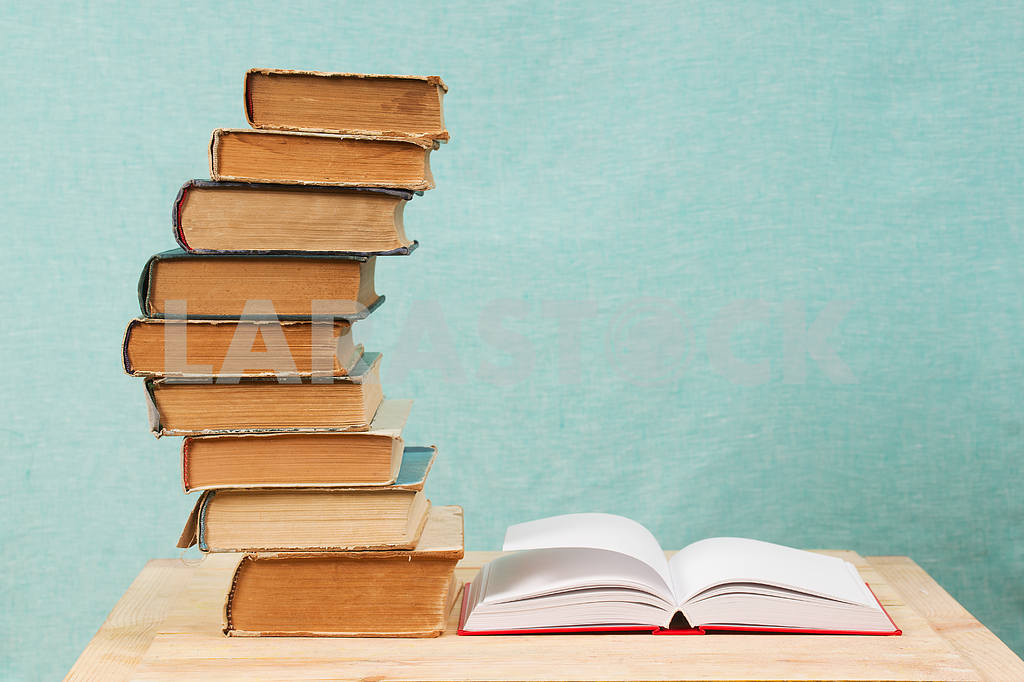 Stack of hardback books on wooden table. Back to school. — Image 47342