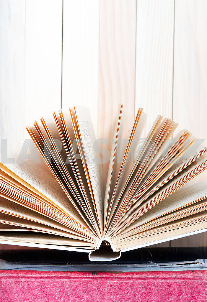 Stack of hardback books on wooden table. Back to school. — Image 47349