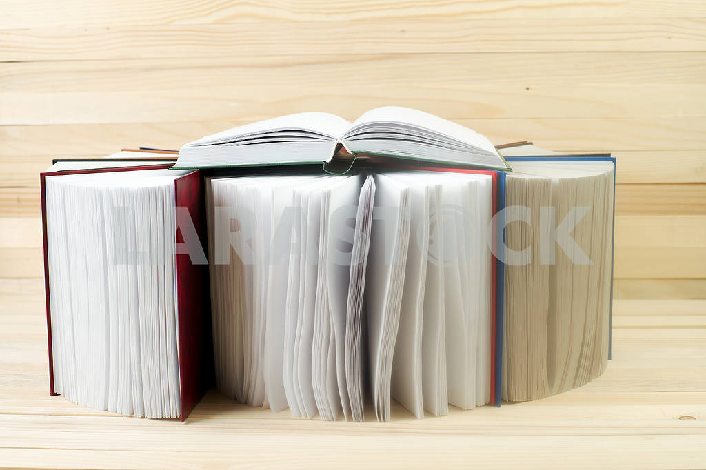 Stack of hardback books on wooden table. Back to school. — Image 47352