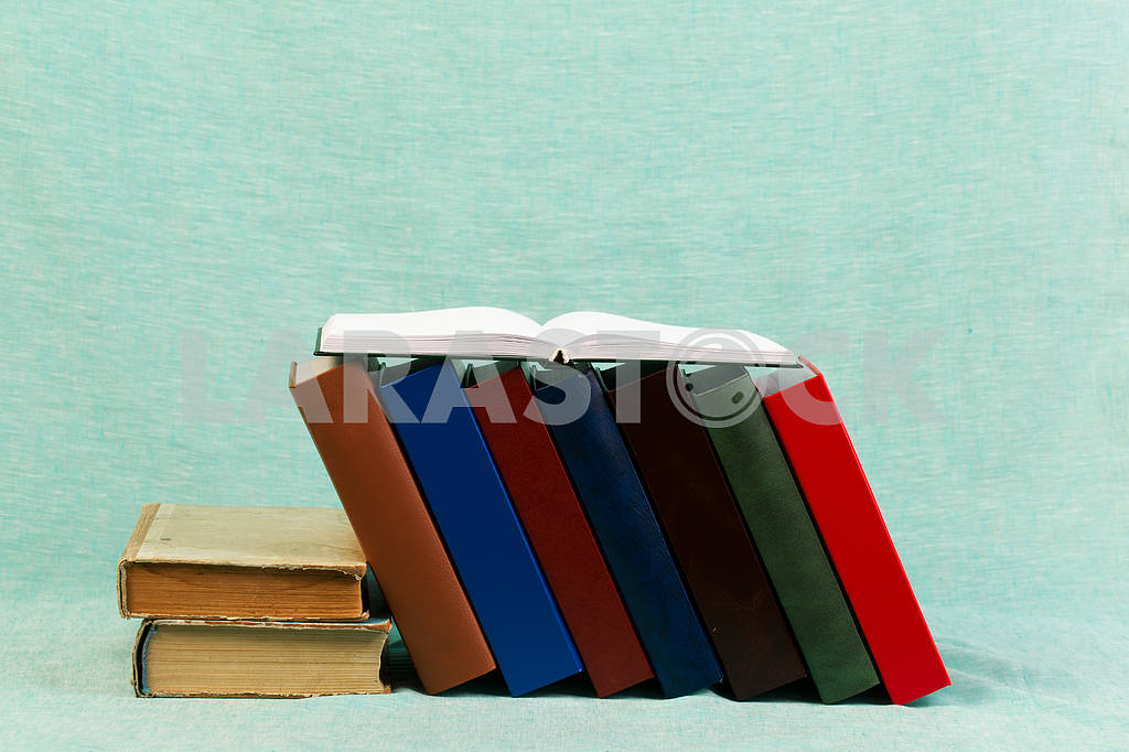 Stack of hardback books on wooden table. Back to school. — Image 47355