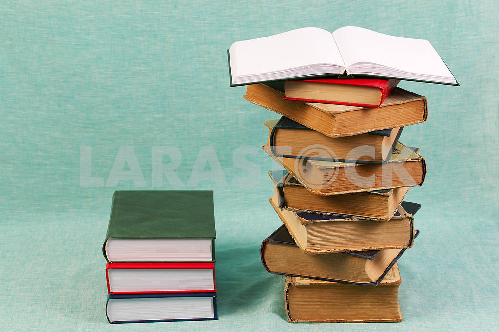 Stack of hardback books on wooden table. Back to school. — Image 47357