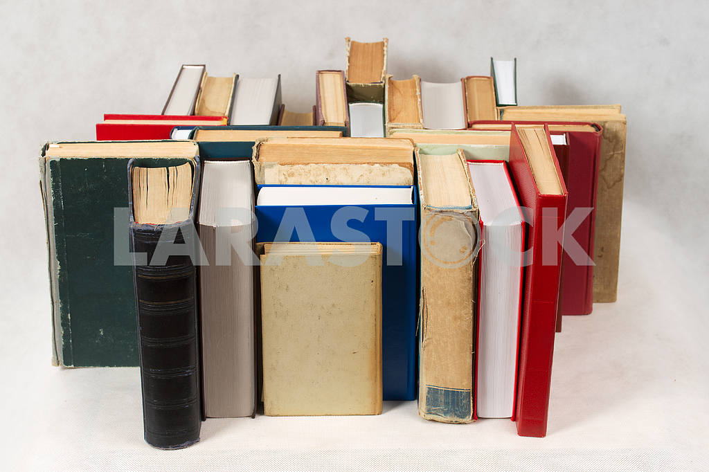 Stack of hardback books on wooden table. Back to school. — Image 47359