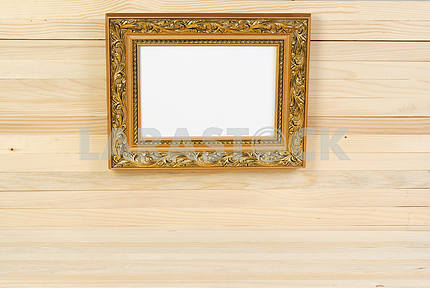 Frame on wooden wall. Interior Design. Copy space