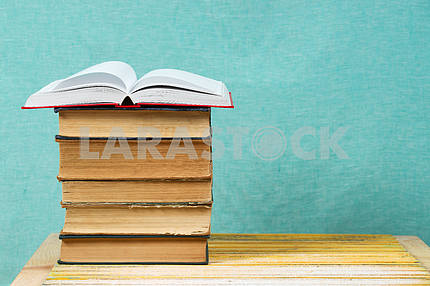Book on wooden table. Back to school. Copy space