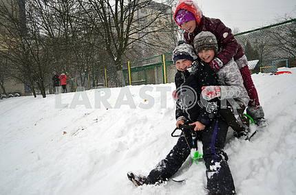 Children sledding in Lviv