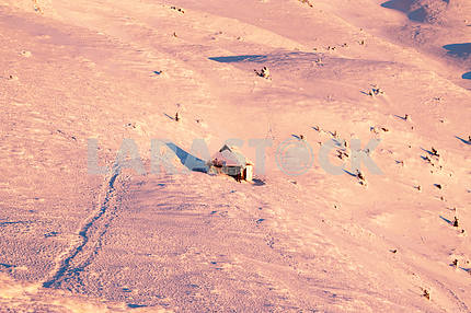 Small wooden house in winter in the mountains. Christmas