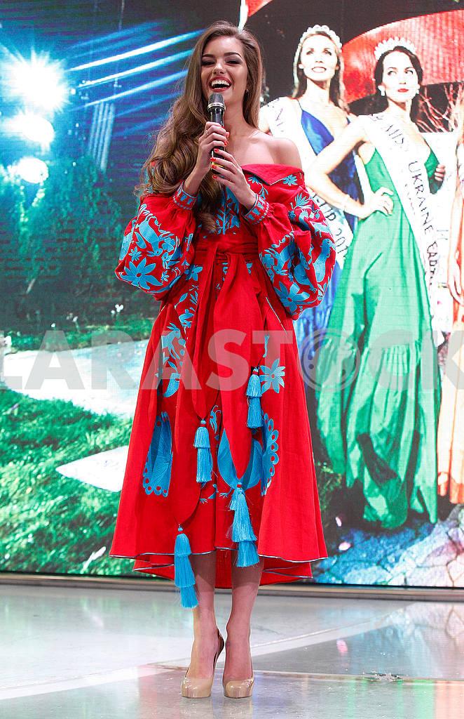 Alexandra Kucherenko in red and blue dress  — Image 48047