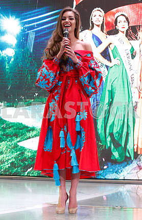Alexandra Kucherenko in red and blue dress