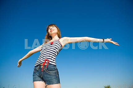 Happy young woman enjoying summer