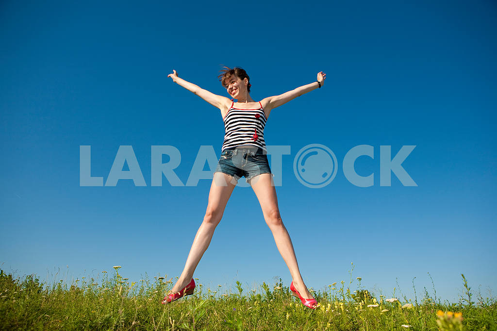 Happy young woman in a field — Image 4816