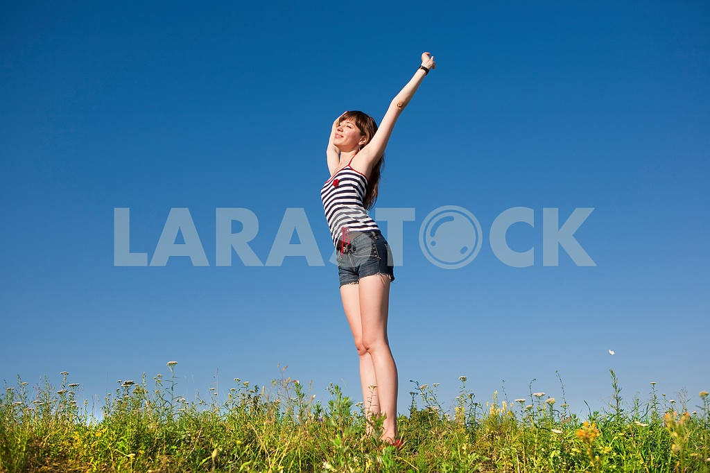 Happy young woman jumping in a field — Image 4821