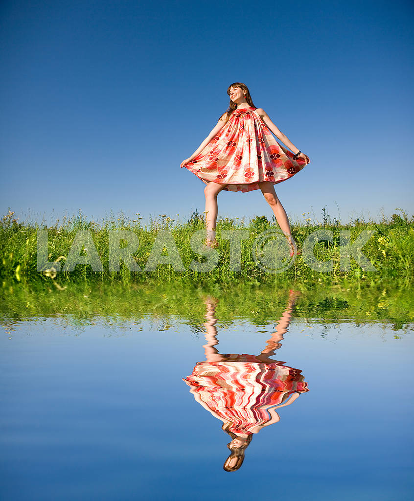 Happy girl fleeing on a meadow. In red dress and red shoes. Agai — Image 4854