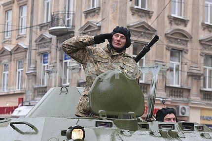 The commander of an armored troop carrier on the march of the defenders of the Fatherland in Lviv