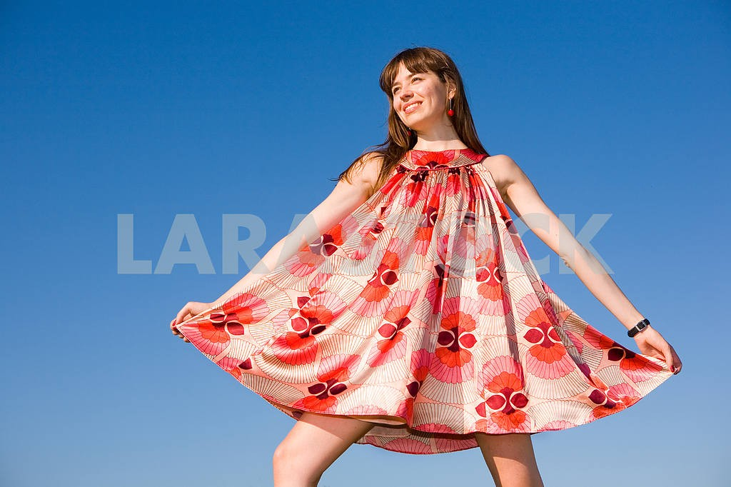 Happy girl fleeing on a meadow. In red dress and red shoes. Agai — Image 4856