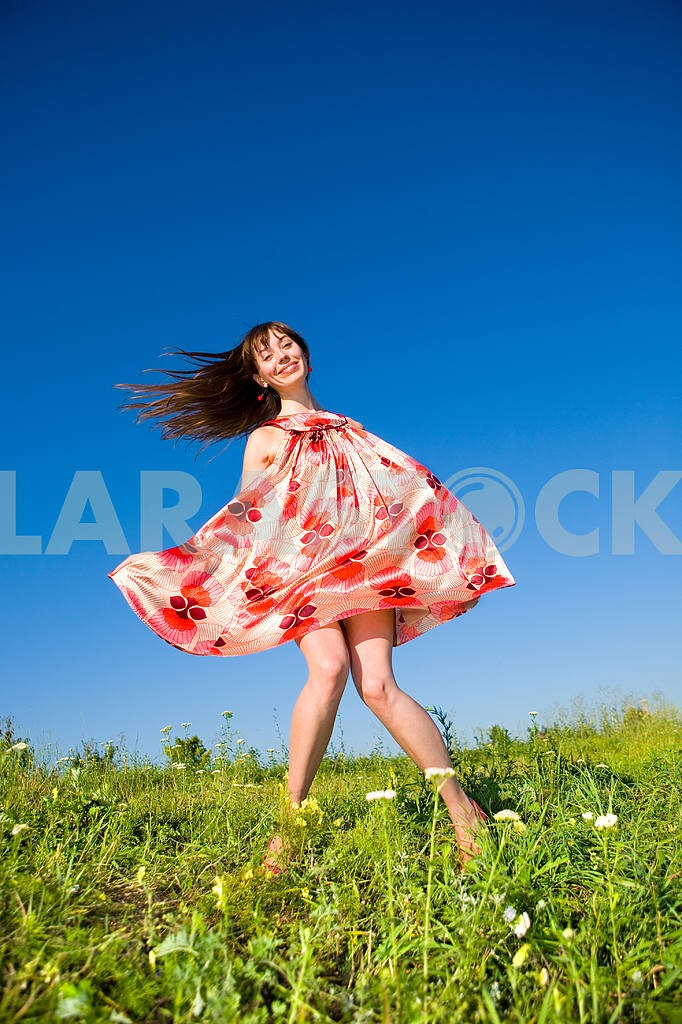 Happy girl fleeing on a meadow. In red dress and red shoes. Agai — Image 4866