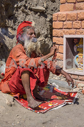 Sadhu smokes