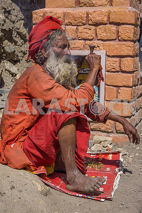 Sadhu smokes marijuana