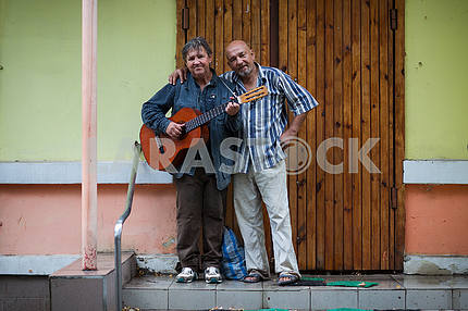 Two men with a guitar