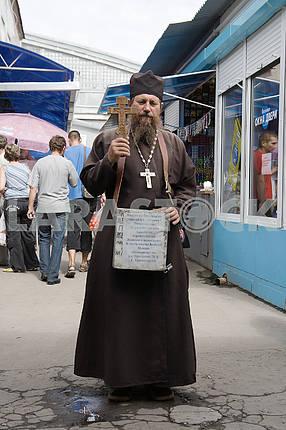 The priest raises money