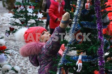 A girl near a Christmas tree in Chernivtsi